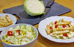 Cabbage salad and celery chips Stock Photos
