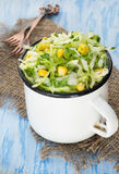 Cabbage salad with corn in vintage cup Stock Photos