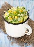 Cabbage salad with corn in vintage cup Stock Photography