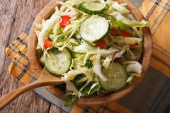 Cabbage salad with cucumbers in a bowl horizontal top view Royalty Free Stock Photography