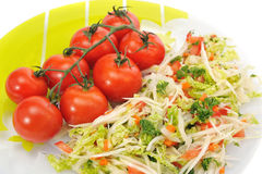 Cabbage salad and tomatoes on a white background royalty free stock photography