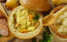 Cabbage soup in a loaf of bread stock image