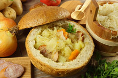 Cabbage soup in a loaf of bread stock photos