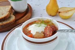 Cabbage soup with sausage. Cabbage soup with sour cream and sausage Royalty Free Stock Photography