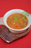 Cabbage soup. Tasty dish on red background royalty free stock image