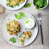 Cabbage and spinach pancakes with yogurt dressing Top view Stock Image