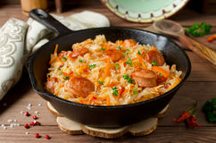 Cabbage stew with grilled sausage Stock Image