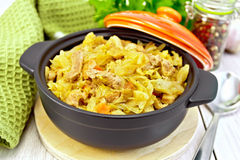 Cabbage stew with meat on light board Royalty Free Stock Photography