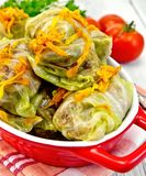 Cabbage stuffed and carrots in red pan on board Royalty Free Stock Photos