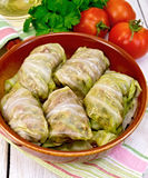 Cabbage stuffed with sauerkraut in pan on napkin Royalty Free Stock Photos