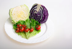 Cabbage, tomato and lettuce. Cabbage, cherry tomato and lettuce Royalty Free Stock Images