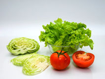 Cabbage tomatoes and salad in bowl on white background. Fresh cabbage tomatoes and salad in bowl on white background Royalty Free Stock Photography