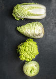 Cabbage variety on dark stone background Stock Images