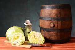 Cabbage and wooden barrel Stock Images