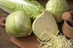 Cabbage on a wooden board on a background sacking, burlap Royalty Free Stock Image