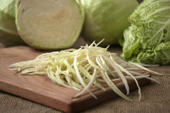 Cabbage on a wooden board on a background sacking, burlap Stock Photography