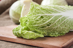 Cabbage on a wooden board on a background sacking, burlap Royalty Free Stock Photography