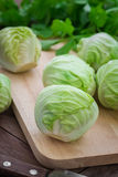 Cabbage on wooden cutting board Stock Photo