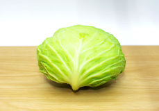 The cabbage on wooden plate. Fresh the cabbage on wooden plate Stock Images