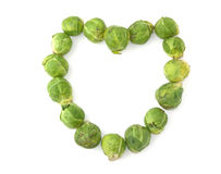 Cabbages hearth. Heart of brussels cabbages on a white background Stock Image