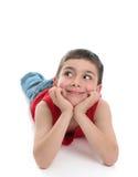 Cabeça bonito do menino nas mãos que olham lateralmente imagem de stock
