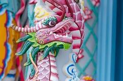 Cabeça colorida da pedra do dragão no templo de buddha Foto de Stock Royalty Free