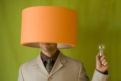 Cabeça da lâmpada do homem de negócios foto de stock