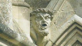 Cabeça da mísula na parte dianteira ocidental da catedral de Salisbúria mim fotografia de stock royalty free