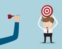Cabeça de Holding Target On do homem de negócios Imagem de Stock Royalty Free