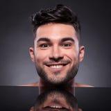 Cabeça do homem novo com expressão soberbo Fotografia de Stock