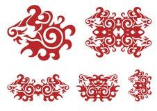 Cabeça do leão e elementos vermelhos ornamentado rodopiados do leão Fotografia de Stock Royalty Free