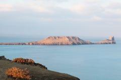 A cabeça do sem-fim, o Gower, Wales no nascer do sol Imagem de Stock