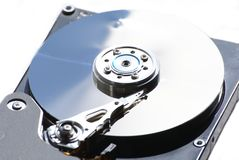Cabeça e disco de disco rígido fotos de stock royalty free