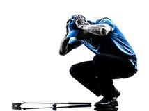 Cabeça golfing do jogador de golfe do homem no handssilhouette Imagem de Stock Royalty Free