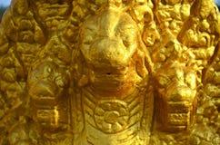 Cabeças douradas da serpente em Phnom Penh Imagem de Stock