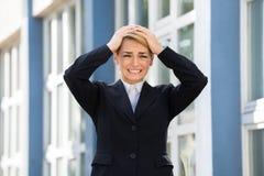 Cabeça triste de With Hands On da mulher de negócios Fotos de Stock