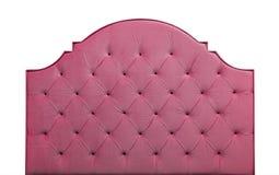 Cabeceira cor-de-rosa da cama de veludo isolada no branco imagem de stock