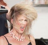 Cabelo da mulher e secador do sopro Fotografia de Stock Royalty Free