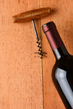Cabernet Bottle and Corkscrew on Wood Stock Images