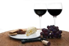 Cabernet Picnic. Red wine glasses with cheese and crackers served on top of wine barrel Stock Photography