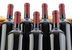 Cabernet Sauvignon Wine Bottles in Crate with Straw. Closeup of seven Cabernet Sauvignon Wine Bottles in Crate with Straw on a white background Royalty Free Stock Images