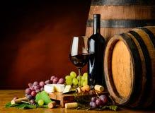Cabernet Sauvignon wine, grapes and cheese Stock Photos