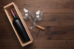Cabernet Wine Bottle in Wood Box with Glasses and Corkscrew Stock Image