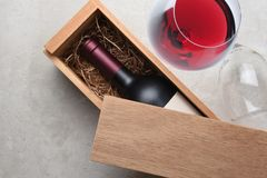 Cabernet Wine Box: A single bottle of red wine in a wood box par stock photo