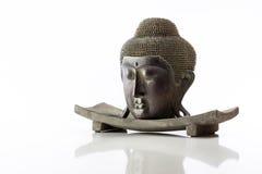 Cabeza de Buda en un fondo blanco Foto de archivo libre de regalías