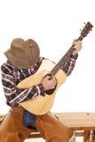 Cabeza de la guitarra del juego del vaquero abajo Imágenes de archivo libres de regalías