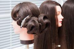 Cabeza de los maniquíes con el peinado Fotografía de archivo