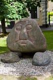 Cabeza de piedra en Riga Imagenes de archivo