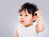 Cabeza del rasguño del bebé Fotografía de archivo libre de regalías