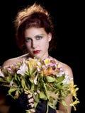 Cabeza roja con las flores Fotografía de archivo libre de regalías